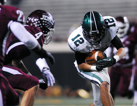 Norman North's Jake Higgenbotham (12) prepares top take a hit as he runs with the ball during the Timberwolves' game against Jenks Friday  during the 6A State championship football game in Stillwater.<br /> Kyle Phillips/The Transcript