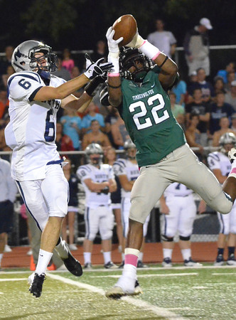 Norman North's Adim Chukwurah grabs the ball on a pass play trying to get an interception Thursday night during the Timberwolves' game against the Huskies at Harve Collins Field.  Chukwurah dropped the ball on the play.<br /> Kyle Phillips/The Transcript