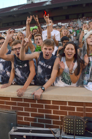 Norman North  football fans cheer on their team Thursday night during the Crosstown Clash between the Norman High Tigers and Norman North Timberwolves at Oklahoma Memorial Field.<br /> Kyle Phillips/The Transcript