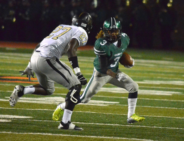 Norman North running back Bryan Payne (3) tries to get around Broken Arrow's Gyasi Akam (27) Friday night during the Timberwolves' game against the Tigers at Harve Collins Field.<br /> Kyle Phillips/The Transcript