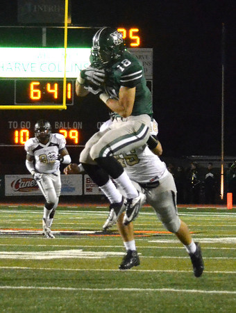 Norman North's Tyler Sipe (18) makes a leaping catch Friday night during the Timberwolves' game against the Tigers at Harve Collins Field.<br /> Kyle Phillips/The Transcript