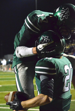 Norman North's Channing Meyer (17) celebrates with receiver Corbin Cleveland (20) after Cleveland catches a touch down pass Friday during the Timberwolves' game against Broken Arrow at Harve Collins Field.<br /> Kyle Phillips/The Transcript