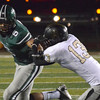 Norman North's Jordan Evans (6) pushes away Broken Arrow's Gabe Johnson (13) as he runs with the ball Friday during the Timberwolves' game against the Tigers at Harve Collins Field.<br /> Kyle Phillips/The Transcript
