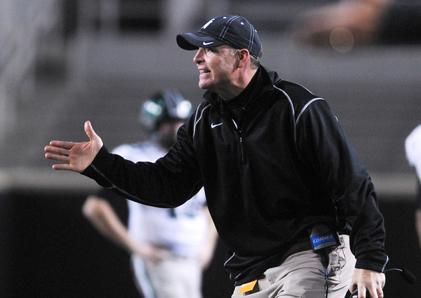 Norman North Football Coach Wade Stanley yells at an official over a call  during the Timberwolves' game against Jenks in the 6A State championship football game in Stillwater.<br /> Kyle Phillips/The Transcript