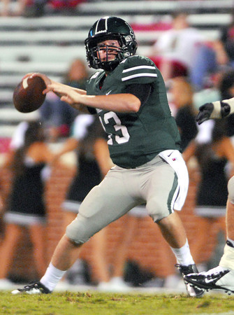 Norman North quarterback Payton Gravas rears back to throw a pass Thursday during the Clash football game at Owen Field.<br /> Kyle Phillips/The Transcript