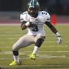 Norman North's Bryan Payne (3) runs with the ball Thursday during the Timberwolves' game against Westmoore at Moore Stadium.<br /> Kyle Phillips/The Transcript