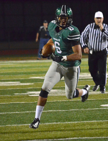 Norman North's Jordan Evans (6) runs with the ball Friday during the Tomberwolves' game against Broken Arrow at Harve Collins Field.<br /> Kyle Phillips/The Transcript