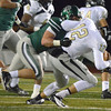 Norman North's Jaxon Uhles (44) sacks Broken Arrow quarterback Coleman Key (12) Friday during the Timberwolves' game against the Tigers at Harve Collins Field.<br /> Kyle Phillips/The Transcript