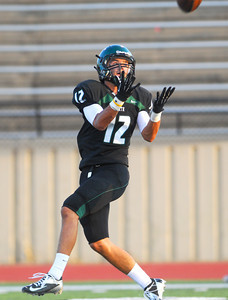 Norman North's Jake Higginbotham (12) brings in a pass during the Timberwolves' game against Edmond Santa Fe Thursday during a scrimmage at Moore High School. Kyle Phillips/The Transcript