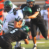 Norman North's Jordan Evans (6) and Lavonte Doxey (47) bring down Edmond Santa Fe quarterback Justice Hansen (11) during the Timberwolves' scrimmage against Edmond Santa Fe Thursday at Moore High School.<br /> Kyle Phillips/The Transcript