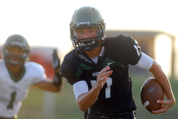 Norman North's Channing Meyer (17) breaks away on a run and scores a touchdown during the Timberwolves' game against Edmond Santa Fe Thursday during a scrimmage at Moore High School.<br /> Kyle Phillips/The Transcript