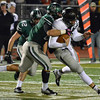 Norman North's Evan Coles (68) sacks Broken Arrow's Coleman Key (12)  Friday night during the Timberwolves' game against the Tigers at Harve Collins Field.<br /> Kyle Phillips/The Transcript