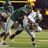 Norman North's Carter Klein tackles Edmond North running back Marque Depp during the Timberwolves' game against the Huskies Thursday at Harve Collins Field.<br /> Kyle Phillips/The Transcript