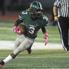 Norman North running back Bryan Payne runs down the field  Thursday night during the Timberwolves' game against Edmond North at Harve Collins Field.<br /> Kyle Phillips/The Transcript