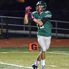 Norman North's Jake Higginbotham brings in a pass before he crosses the goal line Thursday during the Timberwolves' game against the Huskies Thursday at Harve Collins Field.<br /> Kyle Phillips/The Transcript