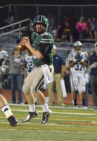 Norman North quarterback Peyton Gravas looks for an open receiver as he prepares to pass the ball during the Timberwolves' game against Edmond North at Harve Collins Field.<br /> Kyle Phillips/The Transcript