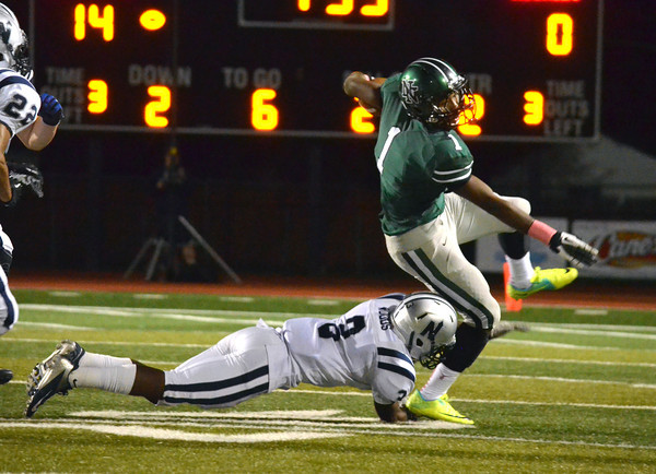 Norman North's Hogan Z'Quan (1) tries to get past Edmond North's Curtis Wood Thursday night during the Timberwolves' game against the Huskies at Harve Collins Field.<br /> Kyle Phillips/The Transcript