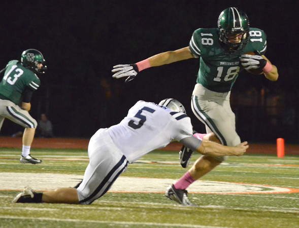 Norman North receiver Tyler Sipe (18) tries to get past Edmond North's Sam Brown (5) Thursday night during the Timberwolves' game against the Huskies at Harve Collins Field.<br /> Kyle Phillips/The Transcript