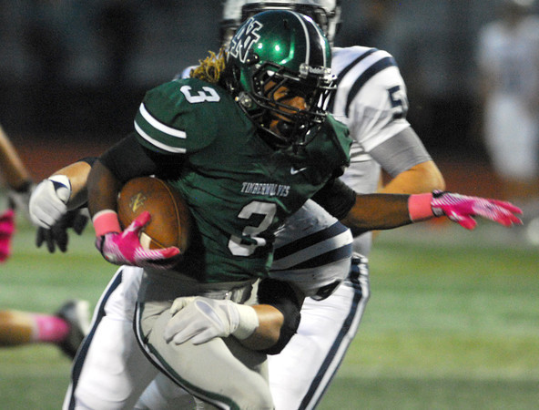 Norman North running back Bryan Payne blasts through the Edmond North defense Thursday night during the Timberwolves' game against the Huskies at Harve Collins Field.<br /> Kyle Phillips/The Transcript