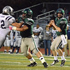 Norman North quarterback Peyton Gravas (13) looks down field for an open receiver as offesive lineman Preston Couch (56) makes a block  Thursday during the Timberwolves' game against Edmond North. Gravas racked up over 400 yards in the Timberwolves' victory over the Huskies.<br /> Kyle Phillips/The Transcript