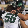 Norman North's Preston Couch(56) and Colin Power(58) react after the Timberwolves lose to Jenks Friday during 6A State championship football game in Stillwater.<br /> Kyle Phillips/The Transcript
