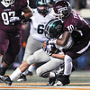 Norman North's Channiong Meyer (17) is pulled down by Jenks' Steven Parker (10) Friday during the Timberwolves' game against Jenks in the 6A State championship football game in Stillwater.