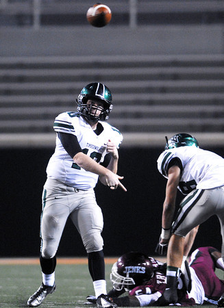 Norman North quarterback Peyton Gavras passes the ball Friday during the Timberwolves' game against Jenks in the 6A State championship football game in Stillwater.