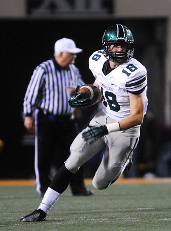 Norman North's Tyler Sipe (18) runs with the ball Friday during the Timberwolves' game against Jenks in the 6A State championship football game in Stillwater.