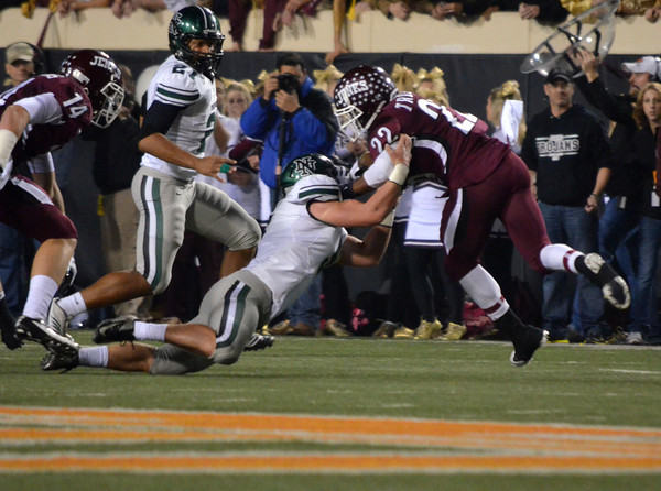 Norman North's Beau Proctor (5) tackles Jenks' Braden Calip (22)  Friday during the Timberwolves' game against the Trojans in the 6A State championship football game in Stillwater.