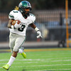 Norman North running back Bryan Payne returns a kickoff during the Timberwolves' game against Midwest City Friday night.<br /> Kyle Phillips/The Transcript