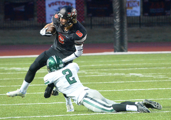Norman North's Keaton Haney (2) tackles Westmoore's Austin Dodd (6) Thursday night during the Timberwolves' game against the Jaguars at Moore Stadium.<br /> Kyle Phillips/The Transcript