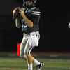 Norman North quarterback Peyton Gavras (13) looks for an open receiver during the Timberwolves' game against Yukon at Harve Collins Field.<br /> Kyle Phillips/The Transcript