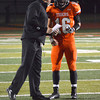 Norman High football coach Greg Nations has a conference with quarterback Zach Long Friday during the Tigers' game against Edmond Santa Fe at Harve Collins Field.<br /> Kyle Phillips/The Transcript