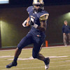 Southmoore's Jalen Adams runs with the ball after catching a pass Friday during the Sabercats' game against the Broncos at Moore Stadium.<br /> Kyle Phillips/The Transcript