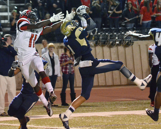 Southmoore's Tre Edwards makes a leaping catch, intercepting a MUstang pass Friday during the Sabercats' game against the Broncos at Moore Stadium.<br /> Kyle Phillips/The Transcript