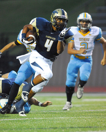 Southmoore's Johnathan Martin (4) runs with the ball during the Sabercats' game against PC West Friday night at Moore Stadium.<br /> Kyle Phillips/The Transcript