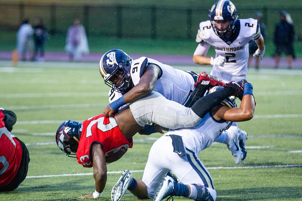 Southmoore's Corey Callens tackles Westmoore's Josiah Hardrick during the Southwest Showdown football game on, Friday, September 07, 2018, at Moore Stadium.