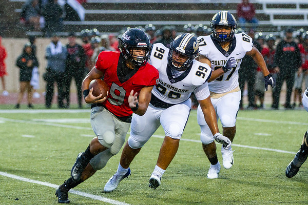 Westmoore's Chris Oliver cutting the corner as Southmoore's Brian Shomali chases him down during the Southwest Showdown football game on, Friday, September 07, 2018, at Moore Stadium.