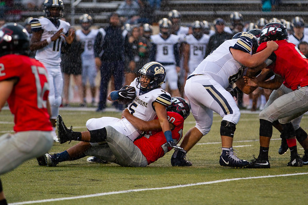 Southmoore's Elijah Brewer carries the ball for a gain of yards during the Southwest Showdown football game on, Friday, September 07, 2018, at Moore Stadium.