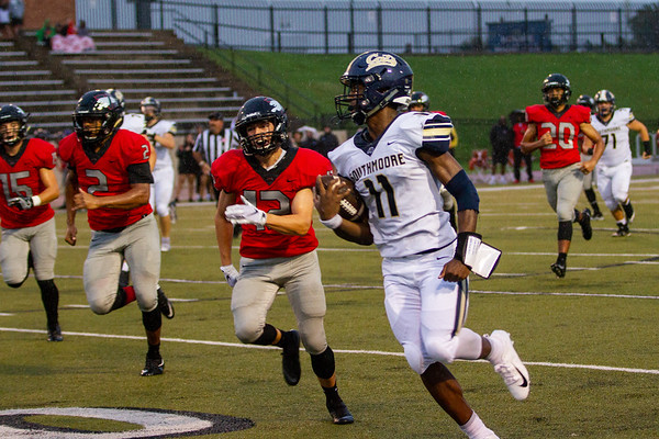 Southmoore's Jaedyn Scott runs down the field with the football during the Southwest Showdown football game on, Friday, September 07, 2018, at Moore Stadium.