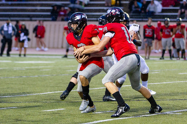 Westmoore's Jace Bohrofen hands the ball to Jacob Clark during the Southwest Showdown football game on, Friday, September 07, 2018, at Moore Stadium.