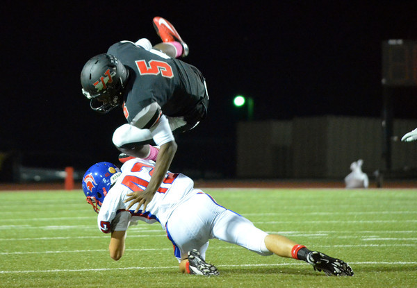 Westmoore quarterback Jhames West (5) flies in the air as he tries to get past a Bixby defender Friday night.<br /> Kyle Phillips/The Transcript