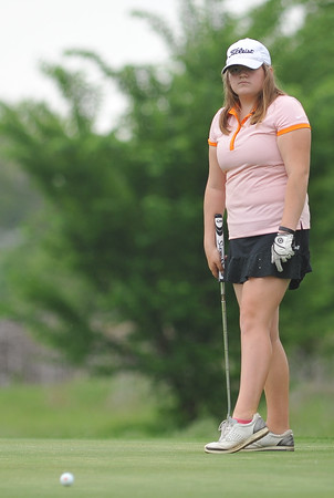 Norman High's Alayna Hagar watches her putt during the regional golf tournament, Tuesday, April 26, 2016, at Early Golf Course. (Kyle Phillips / The Transcript)