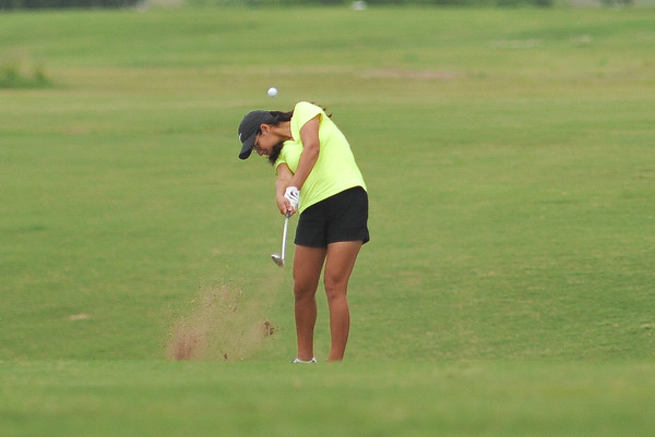 Norman North's Isabella Caamal hits the ball down the fairway during the regional golf tournament, Tuesday, April 26, 2016, at Early Golf Course. (Kyle Phillips / The Transcript)
