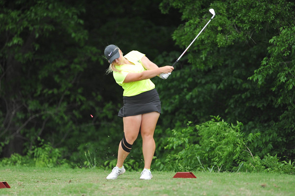 Norman North's Kaitlin Milligan tees off during the regional golf tournament, Tuesday, April 26, 2016, at Early Golf Course. (Kyle Phillips / The Transcript)