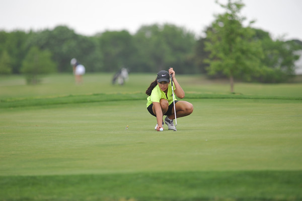 Norman North's Isabella Caamal sets up her shot during the regional golf tournament, Tuesday, April 26, 2016, at Early Golf Course. (Kyle Phillips / The Transcript)