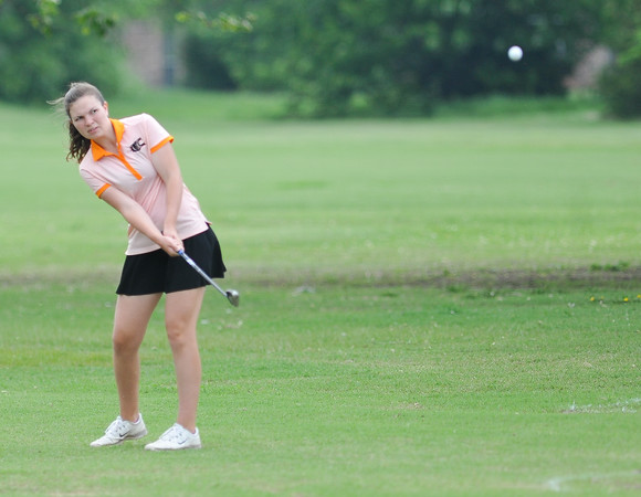 Norman High's Sarah Blough hits the ball down the fairway during the regional golf tournament, Tuesday, April 26, 2016, at Early Golf Course. (Kyle Phillips / The Transcript)