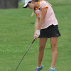 Norman High's Hayden Meiser chips the ball during the regional golf tournament, Tuesday, April 26, 2016, at Early Golf Course. (Kyle Phillips / The Transcript)