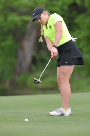 Norman North's Maci Milligan putts the ball during the regional golf tournament, Tuesday, April 26, 2016, at Early Golf Course. (Kyle Phillips / The Transcript)