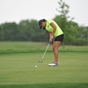 Norman North's Isabella Caamal putts the ball during the regional golf tournament, Tuesday, April 26, 2016, at Early Golf Course. (Kyle Phillips / The Transcript)